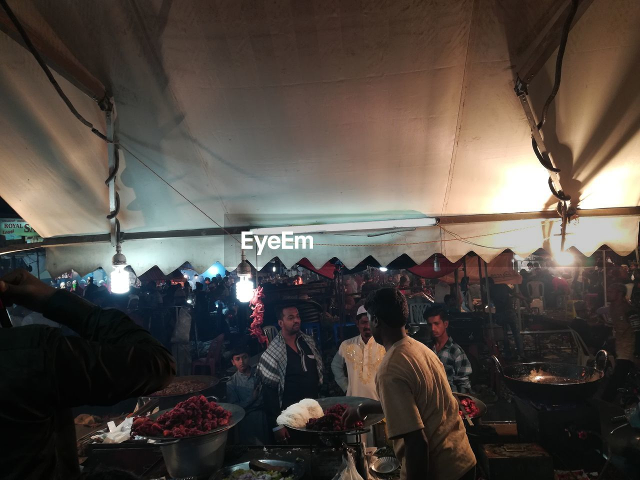 group of people, real people, crowd, large group of people, women, men, adult, market, illuminated, lifestyles, food and drink, business, market stall, indoors, lighting equipment, restaurant, food, leisure activity, architecture, street market, light, ceiling