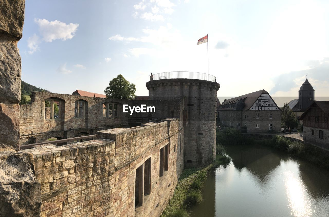 built structure, architecture, sky, water, building exterior, flag, cloud - sky, no people, building, history, nature, day, the past, patriotism, fort, travel destinations, river, outdoors