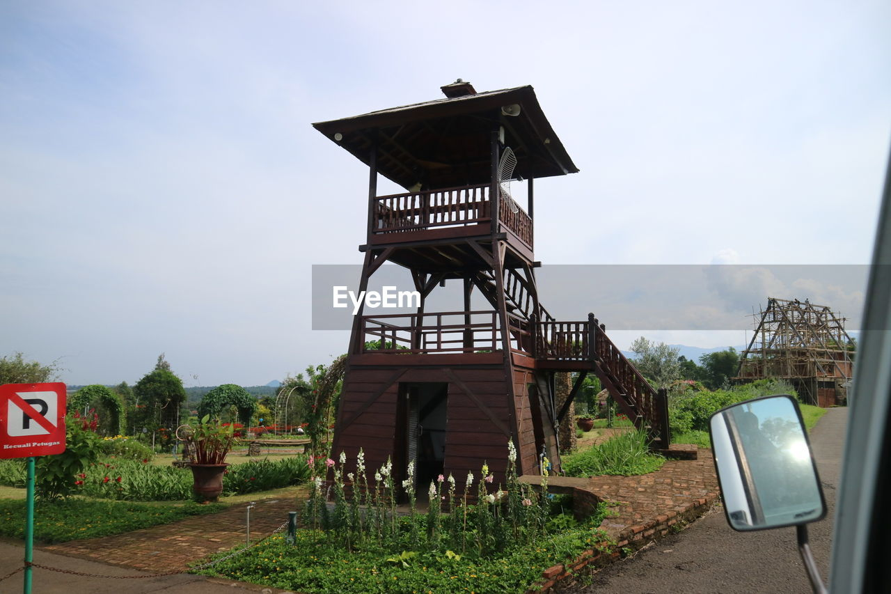 LOW ANGLE VIEW OF TRADITIONAL TOWER AGAINST SKY