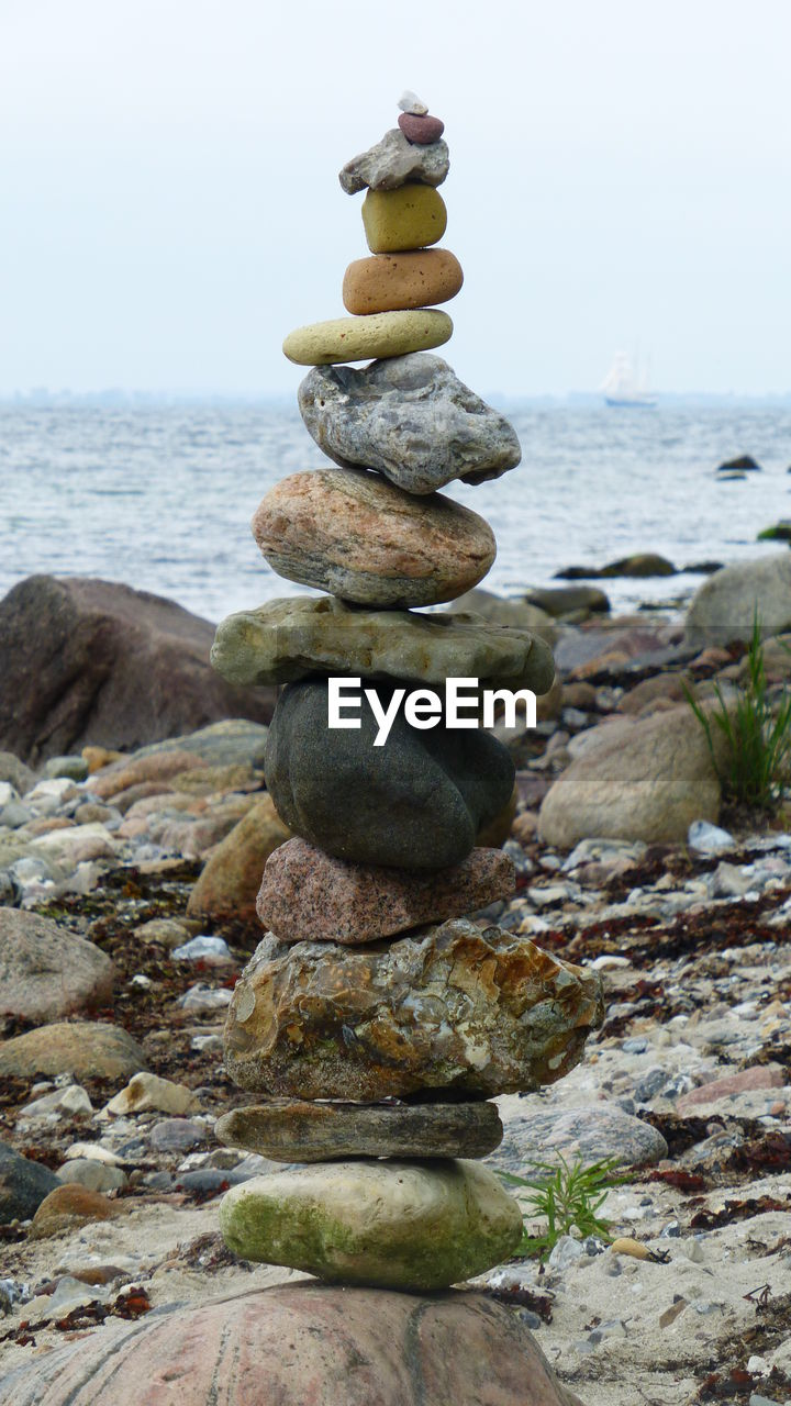 sea, rock - object, water, stack, balance, pebble, nature, horizon over water, tranquility, no people, beauty in nature, day, beach, scenics, sky, outdoors