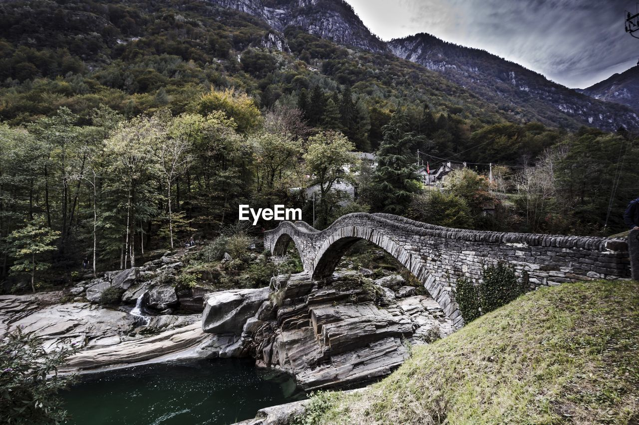 High angle view of ponte dei salti bridge over river against mountains at valle verzasca