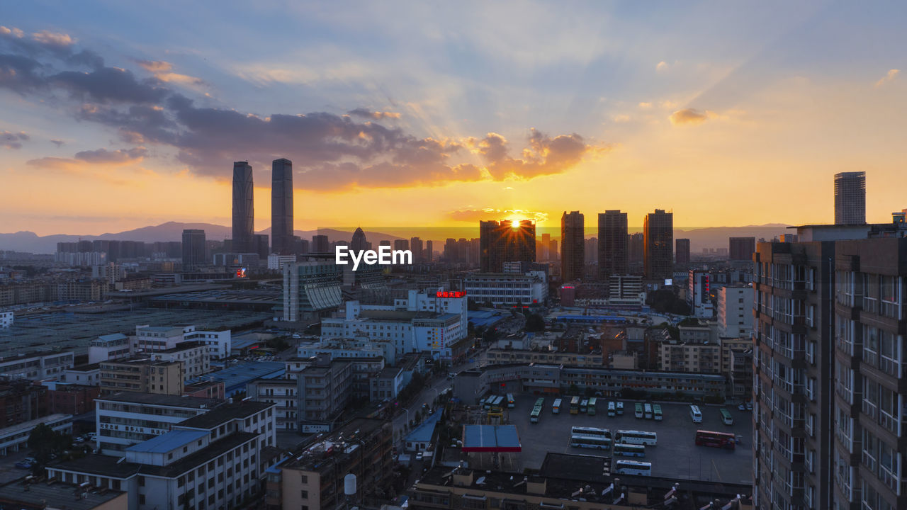 sunset, architecture, city, building exterior, cityscape, skyscraper, built structure, sky, no people, urban skyline, cloud - sky, travel destinations, outdoors, modern, day