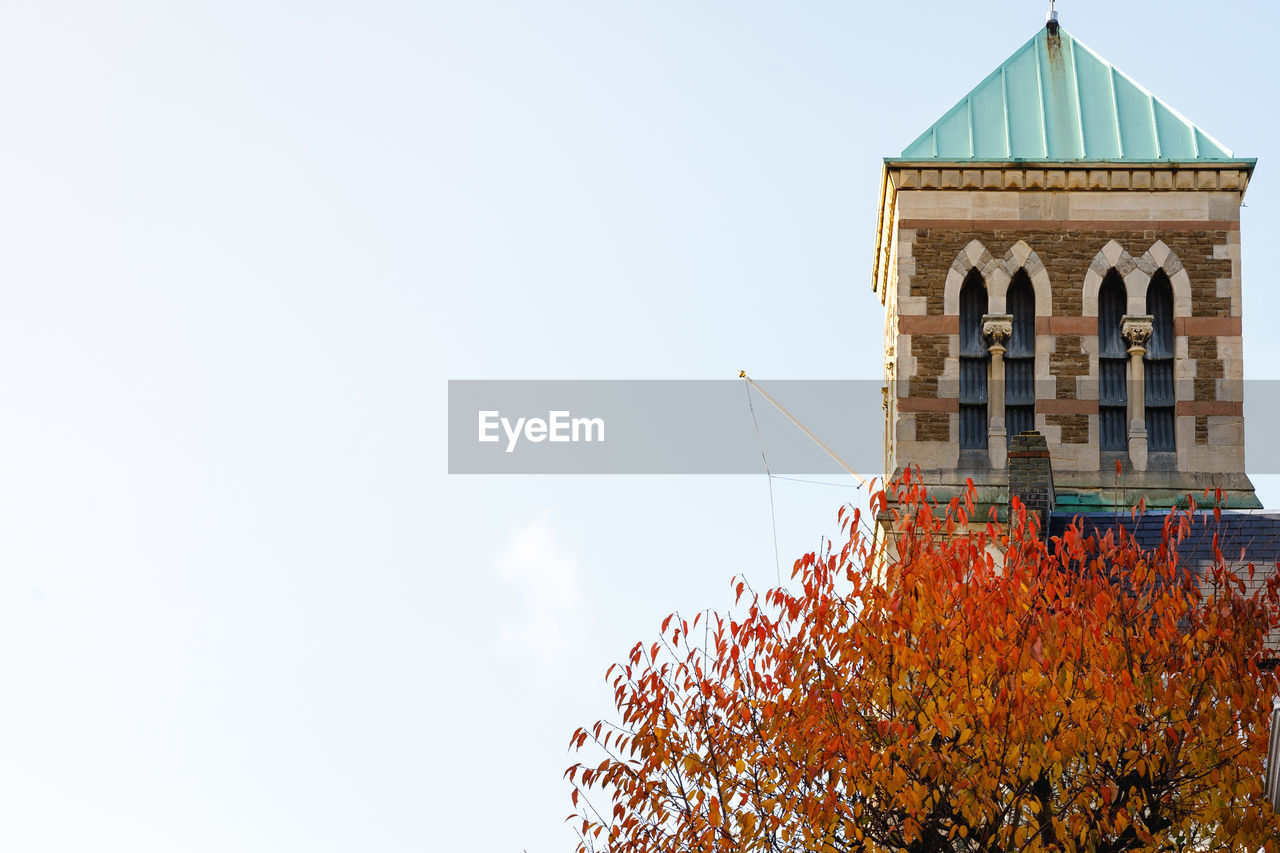 built structure, architecture, building exterior, sky, nature, day, building, low angle view, copy space, autumn, clear sky, religion, change, belief, place of worship, plant, no people, orange color, spirituality, outdoors