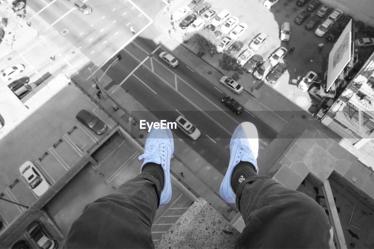 shoe, low section, high angle view, personal perspective, real people, men, human leg, standing, outdoors, day, one person, human body part, city, people