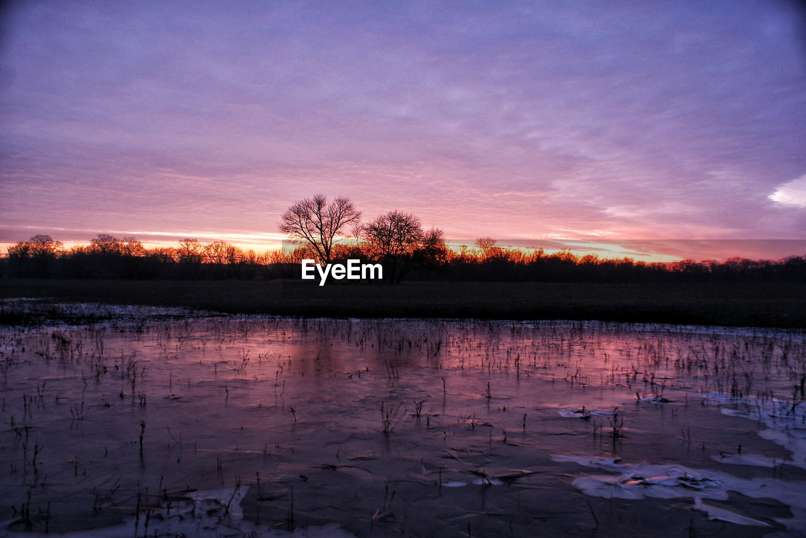 sunset, nature, beauty in nature, tranquil scene, scenics, reflection, tranquility, lake, tree, sky, silhouette, winter, water, outdoors, landscape, cold temperature, no people, snow, travel destinations, cloud - sky, bare tree, day