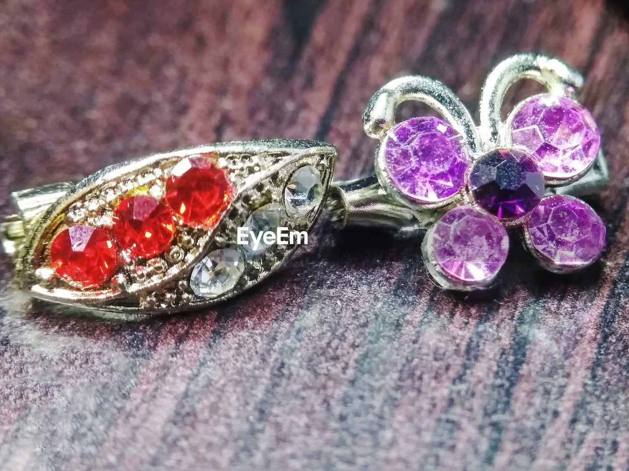 jewelry, wealth, luxury, gemstone, close-up, diamond - gemstone, no people, still life, table, indoors, ring, selective focus, precious gem, shiny, fashion, solid, metal, variation, group of objects, personal accessory, purple, silver colored, ornate, expense