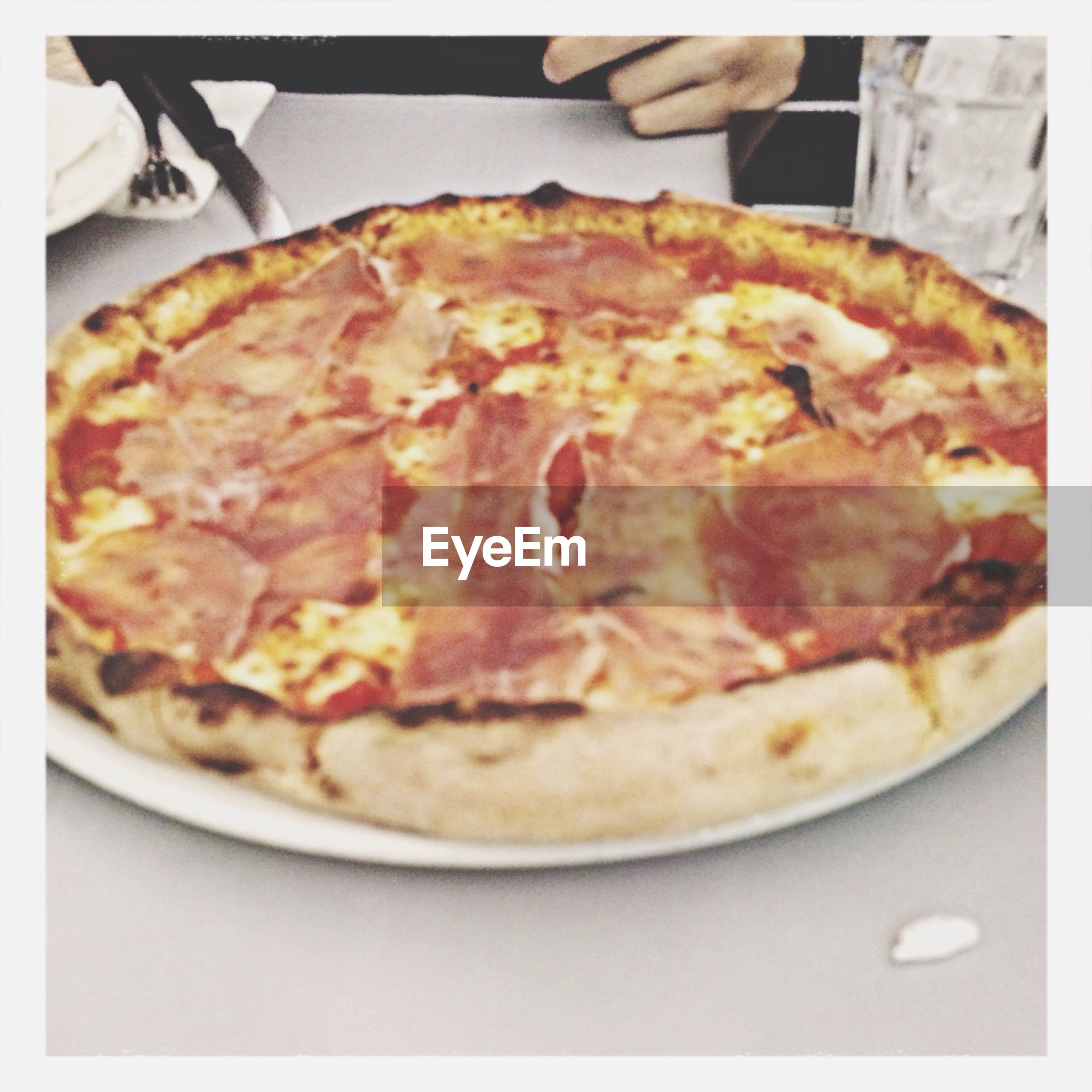 food and drink, food, indoors, freshness, ready-to-eat, close-up, transfer print, plate, pizza, still life, meal, indulgence, unhealthy eating, auto post production filter, serving size, table, meat, high angle view, no people