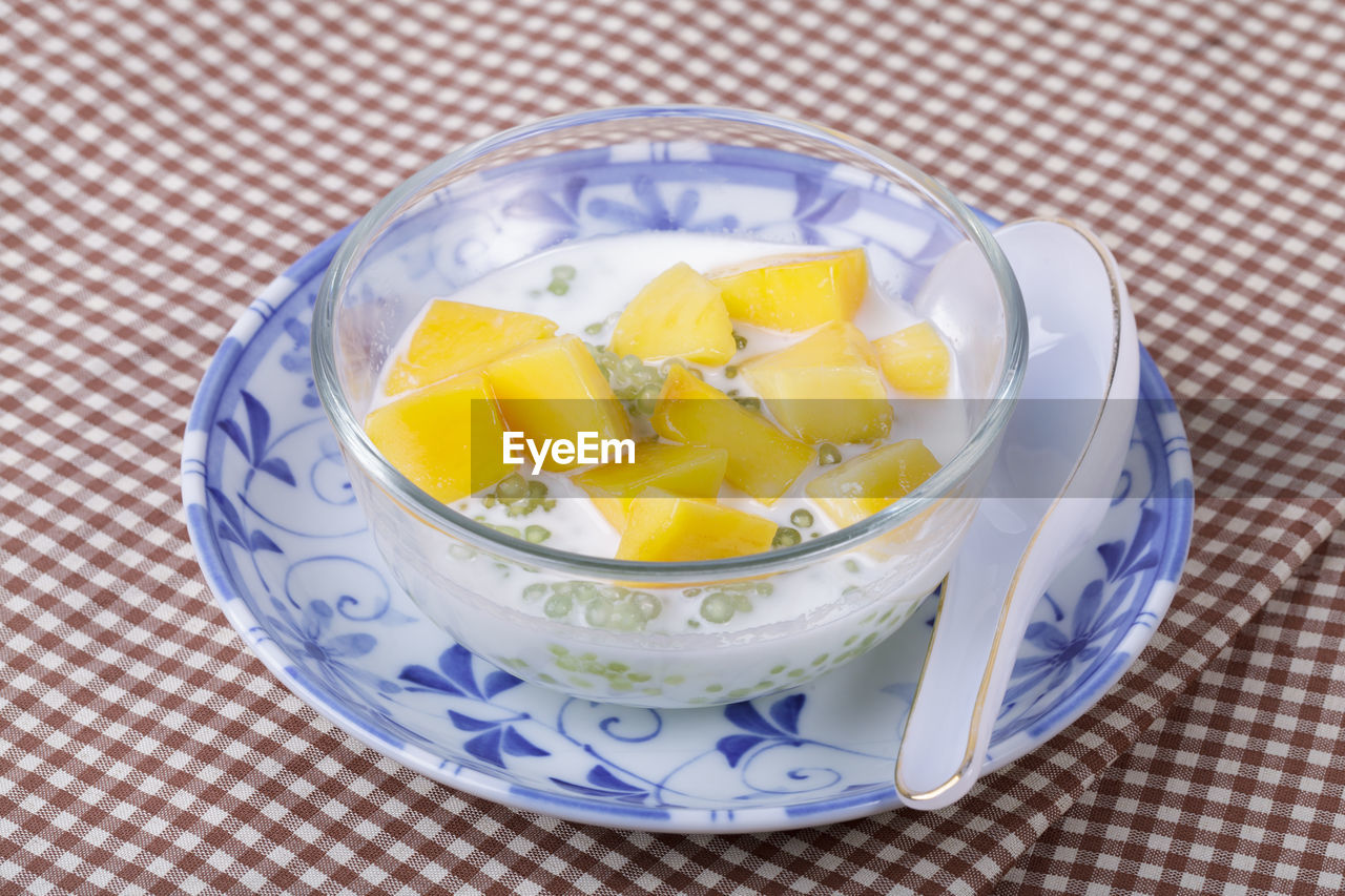 food and drink, food, healthy eating, wellbeing, freshness, tablecloth, ready-to-eat, table, indoors, high angle view, fruit, bowl, close-up, still life, no people, checked pattern, vegetable, slice, serving size, kitchen utensil, breakfast, temptation, fruit salad