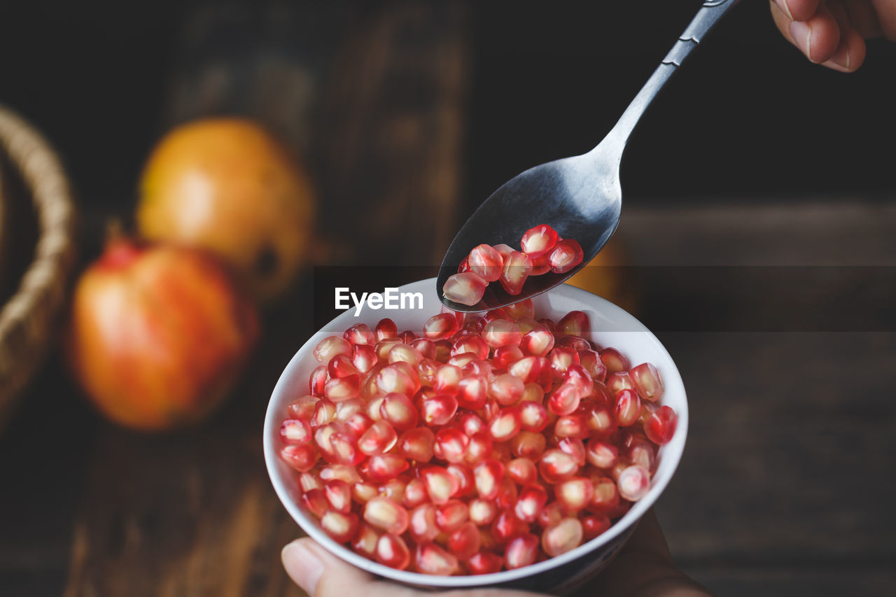 Close-Up Of Pomegranate Seed In Bowl