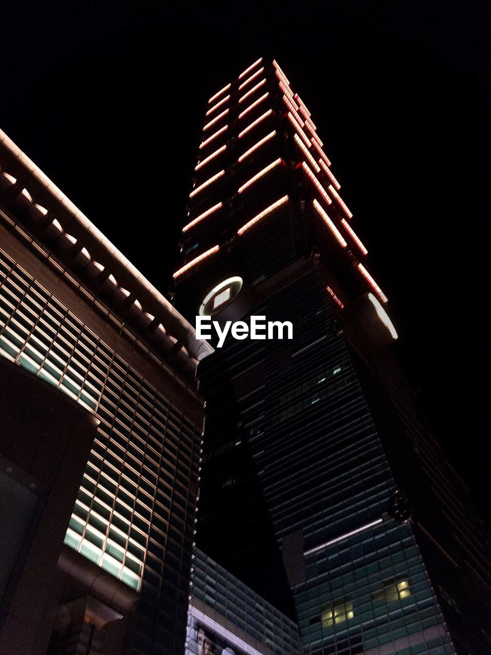 night, low angle view, architecture, built structure, illuminated, building exterior, modern, no people, outdoors, city, skyscraper, sky