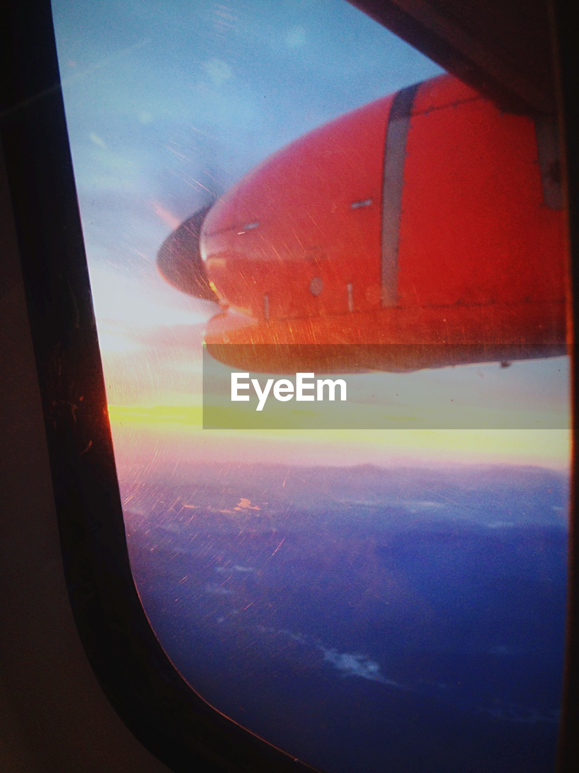 sunset, transportation, sky, sea, window, vehicle interior, mode of transport, transparent, water, scenics, glass - material, beauty in nature, orange color, airplane, nature, indoors, part of, travel, tranquil scene, cloud - sky