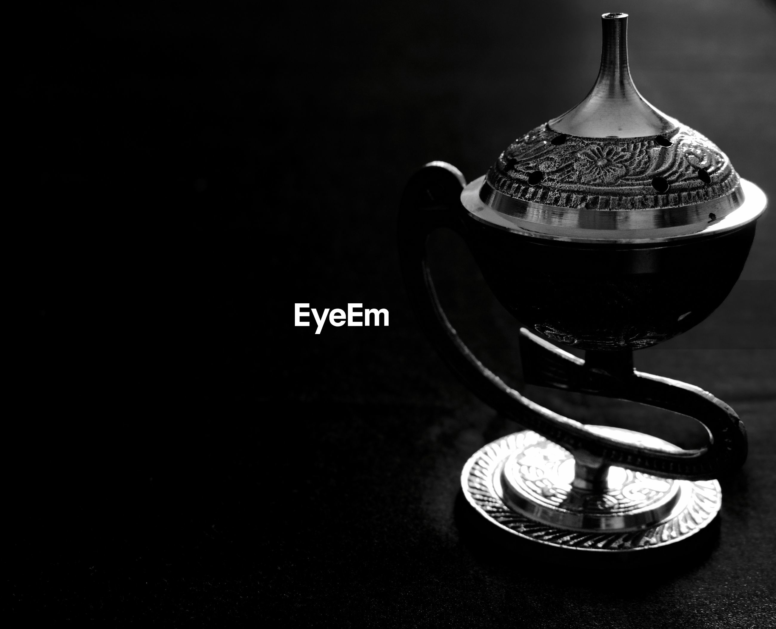 Close-up of censer on table