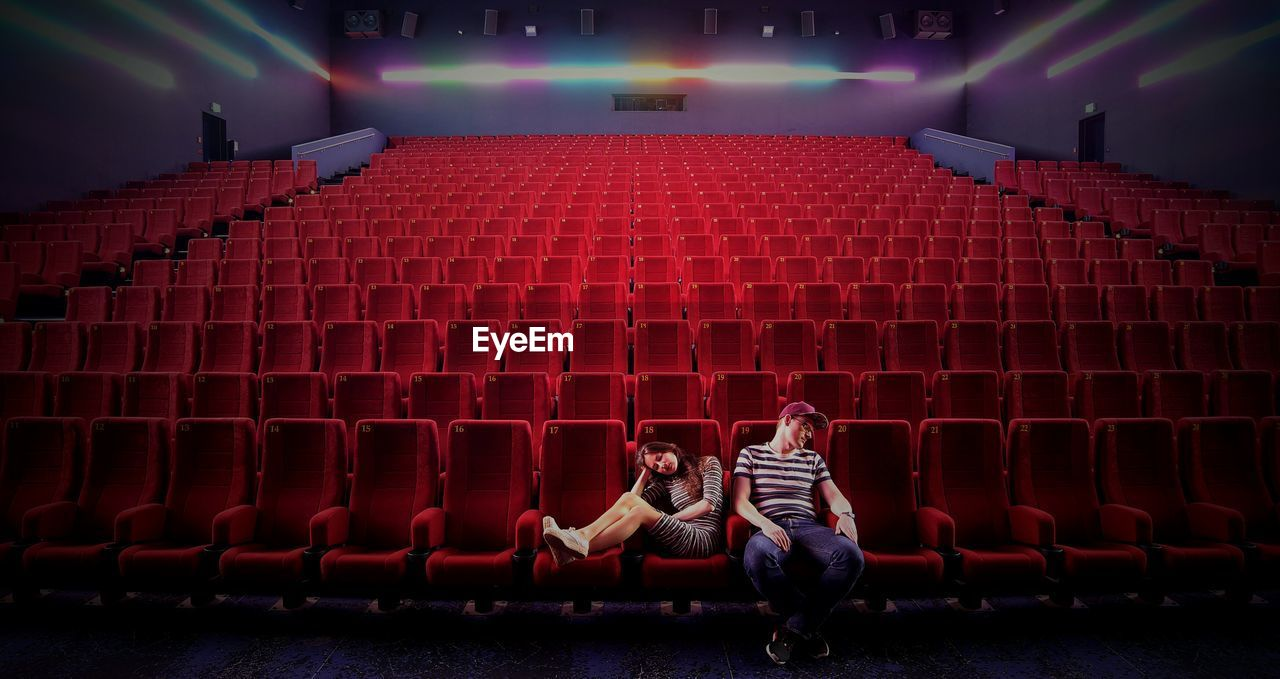 Depressed couple sitting in movie theater