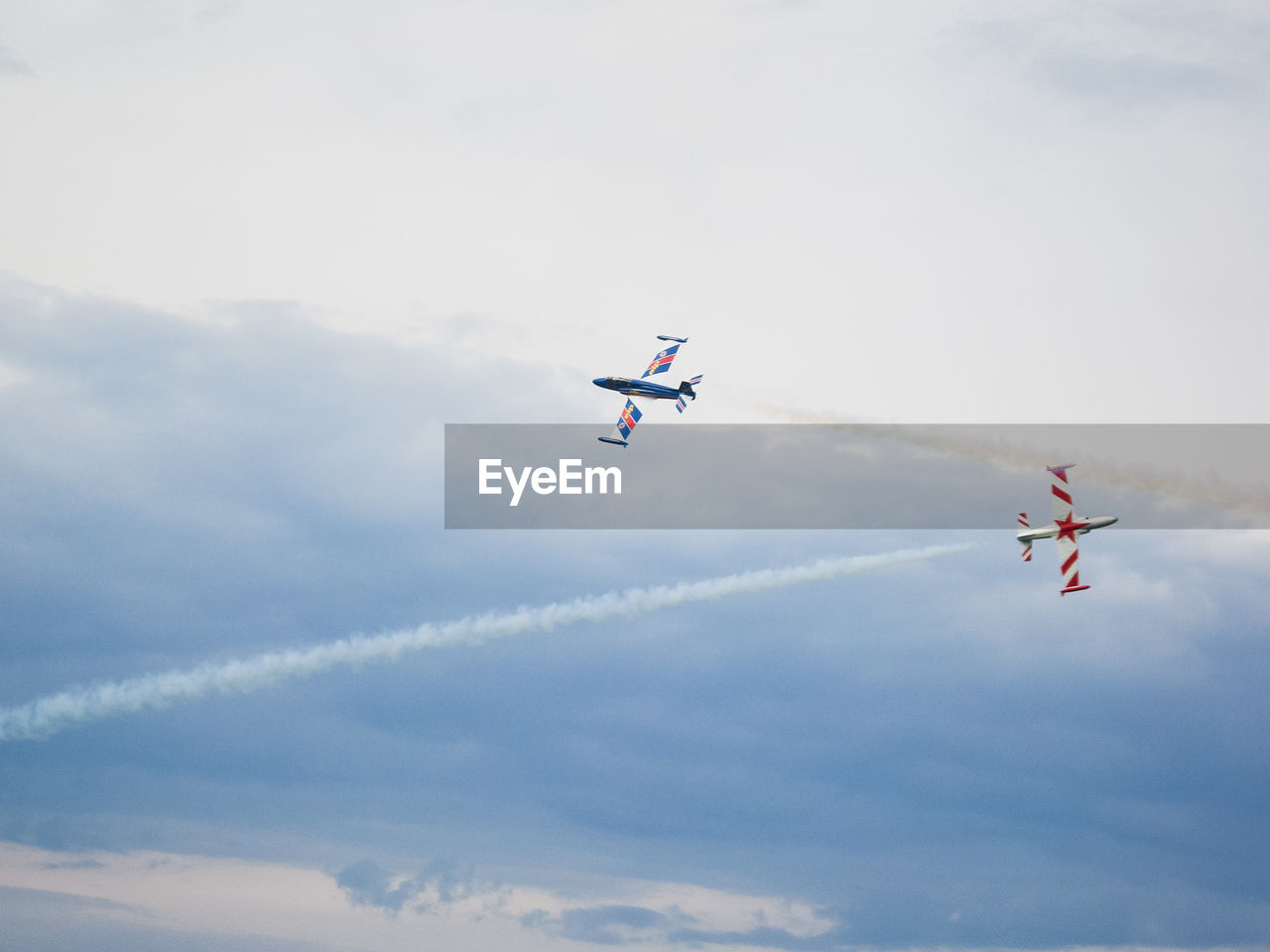 Airplanes Flying In Cloudy Sky