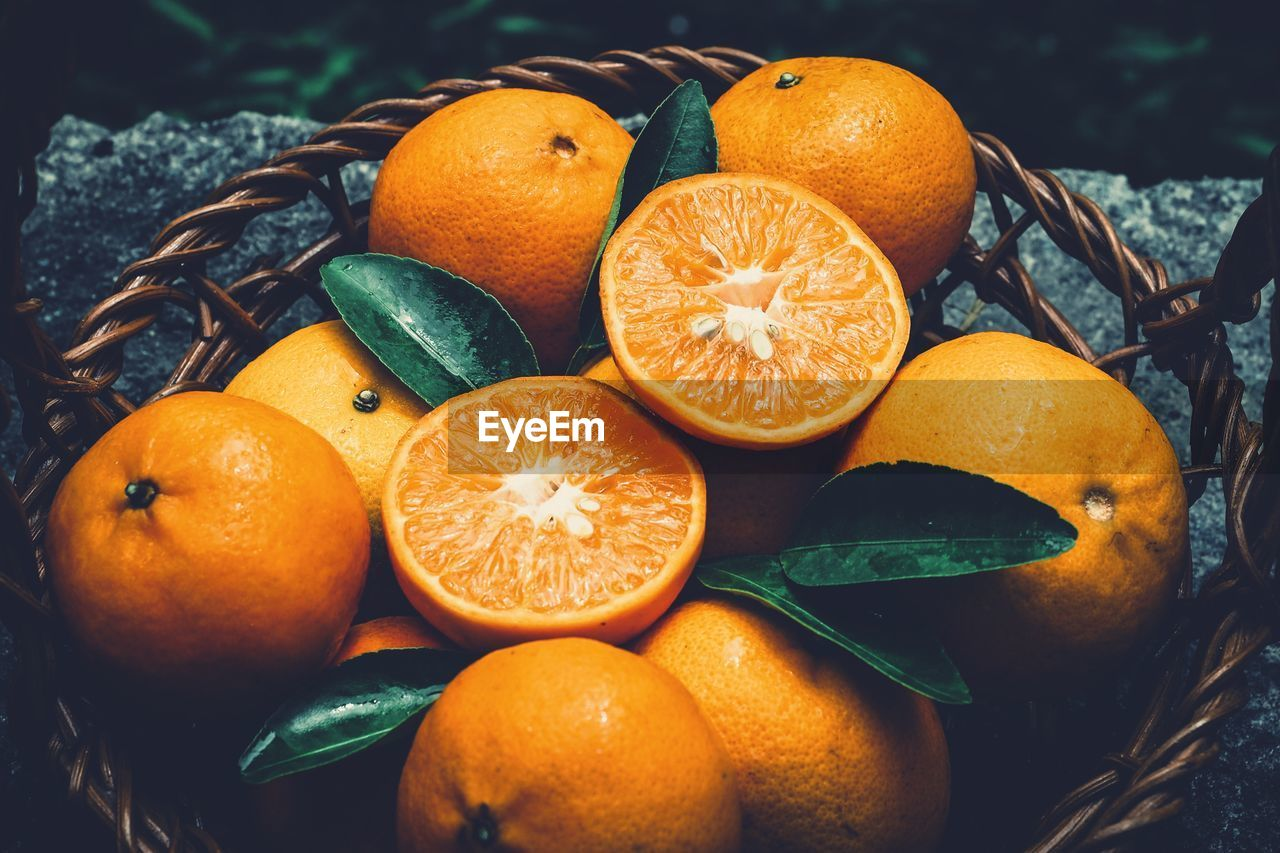High Angle View Of Orange Fruits In Basket