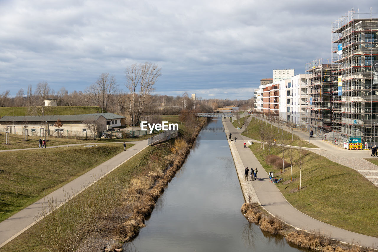 VIEW OF CANAL AND BUILDINGS IN CITY