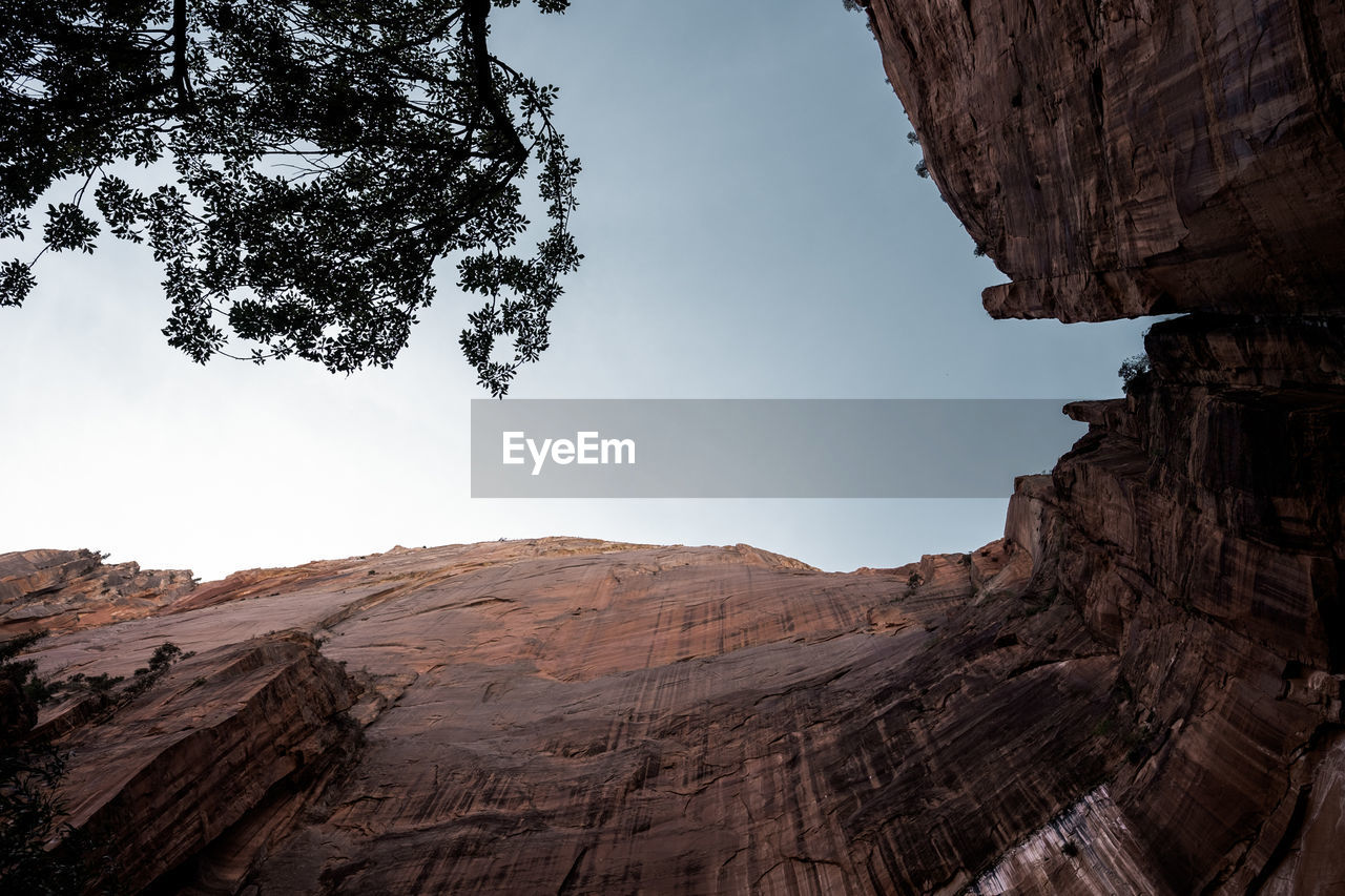Low Angle View Of Rocky Cliff Against Sky At Zion National Park