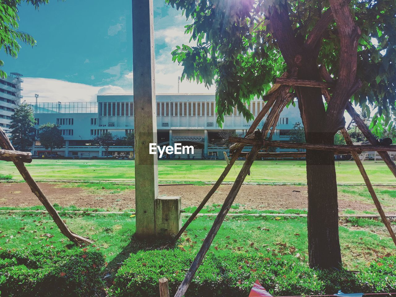 tree, grass, no people, sky, day, architecture, building exterior, outdoors, built structure, field, growth, nature, prison
