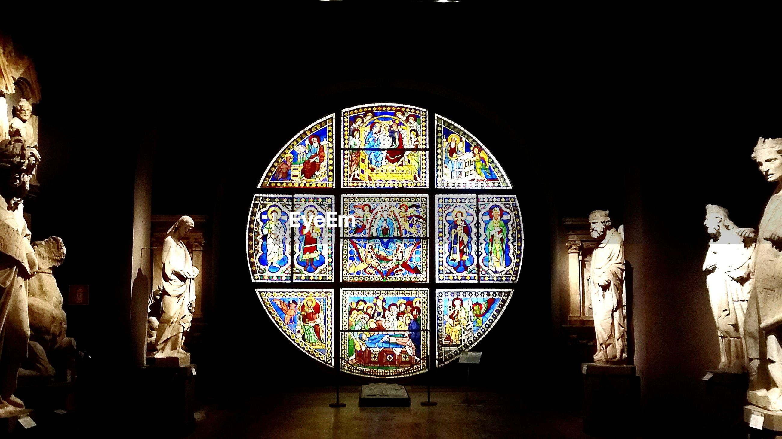 indoors, stained glass, arch, place of worship, religion, spirituality, built structure, architecture, window, design, art, multi colored, church, art and craft, creativity, pattern, ornate, glass - material, low angle view