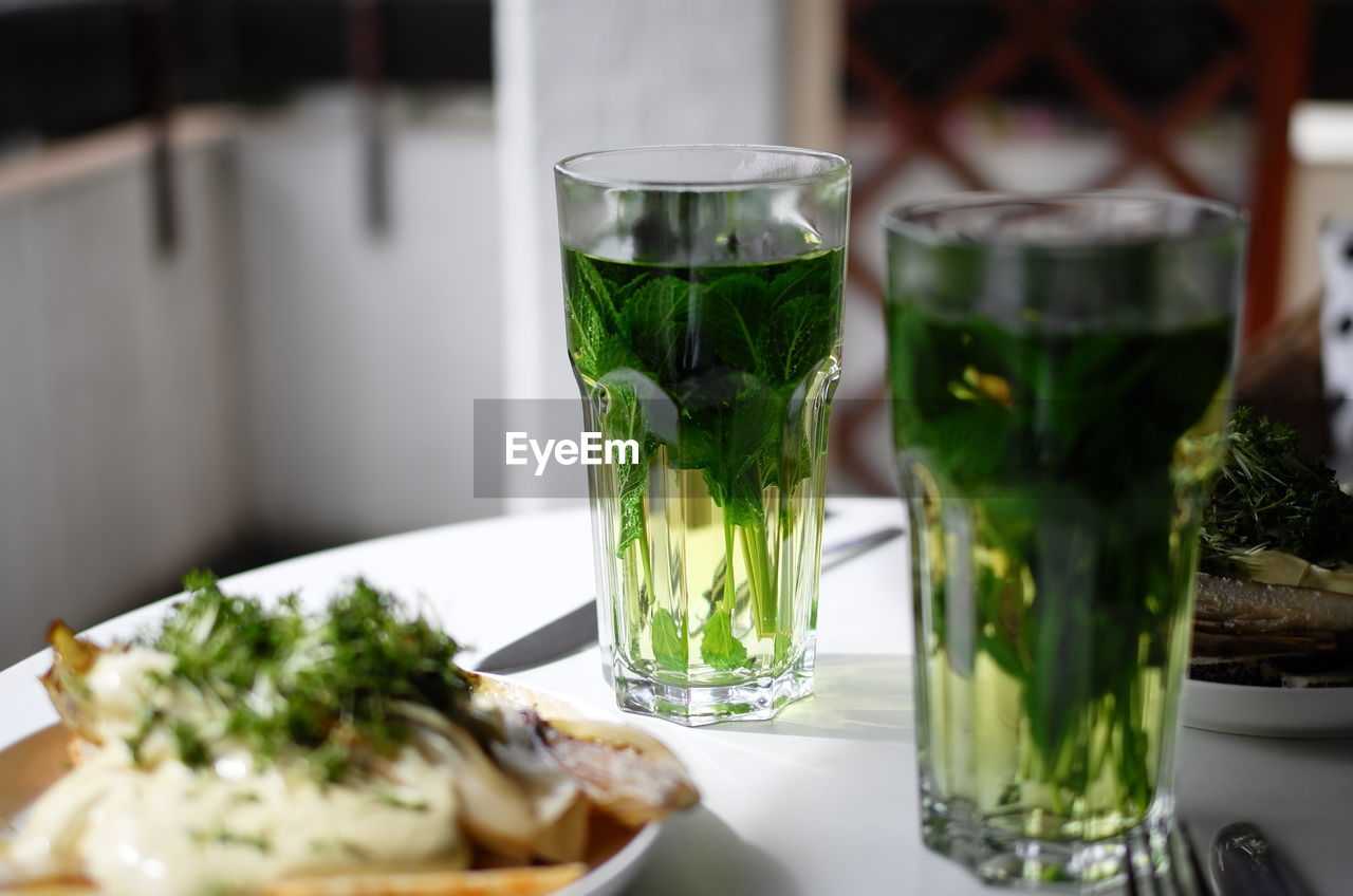 food and drink, table, food, freshness, drink, glass, refreshment, transparent, drinking glass, serving size, close-up, indoors, plate, herb, healthy eating, no people, household equipment, still life, ready-to-eat, glass - material, mint leaf - culinary, temptation