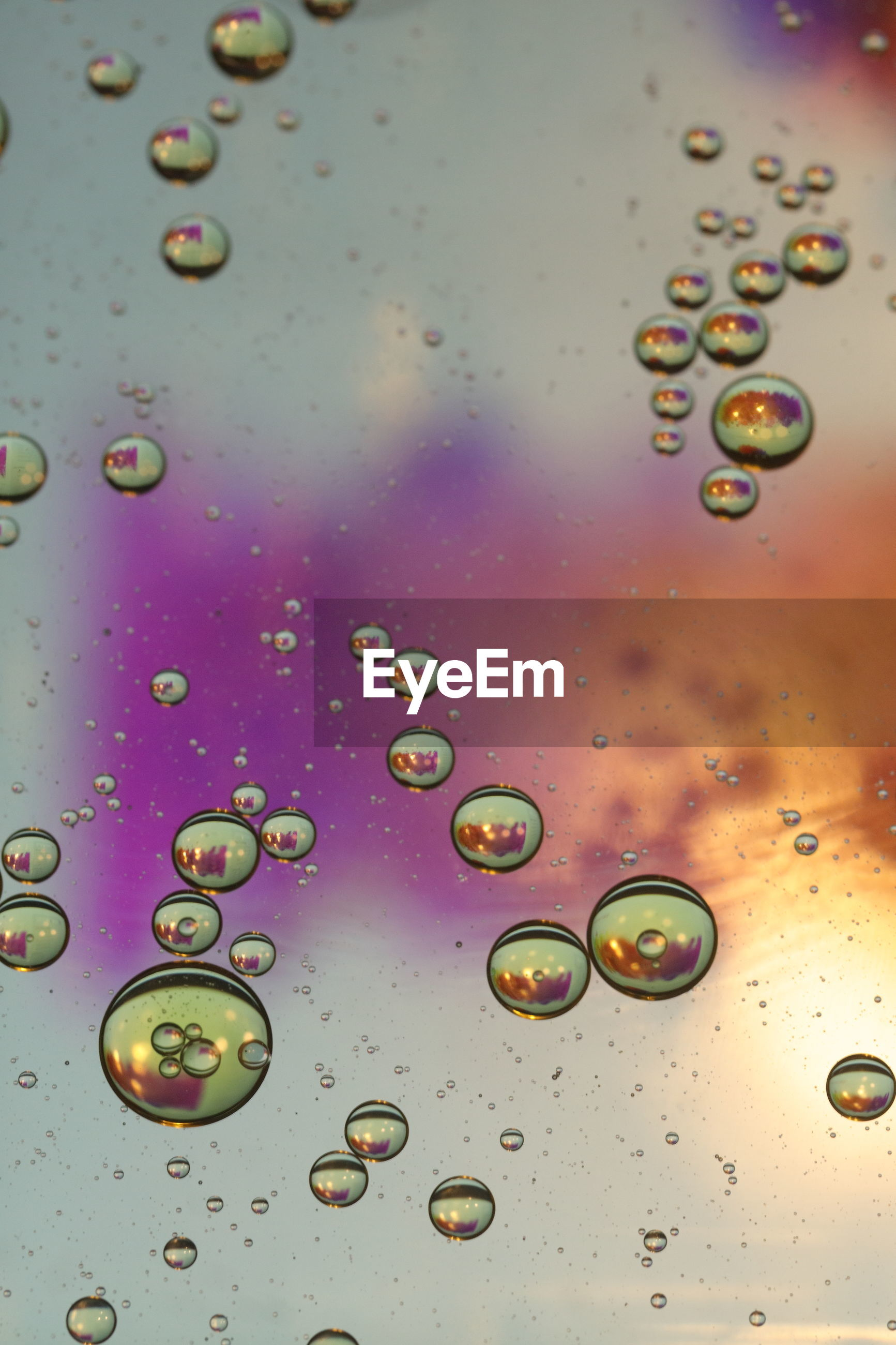 FULL FRAME SHOT OF WATER DROPS ON BUBBLES
