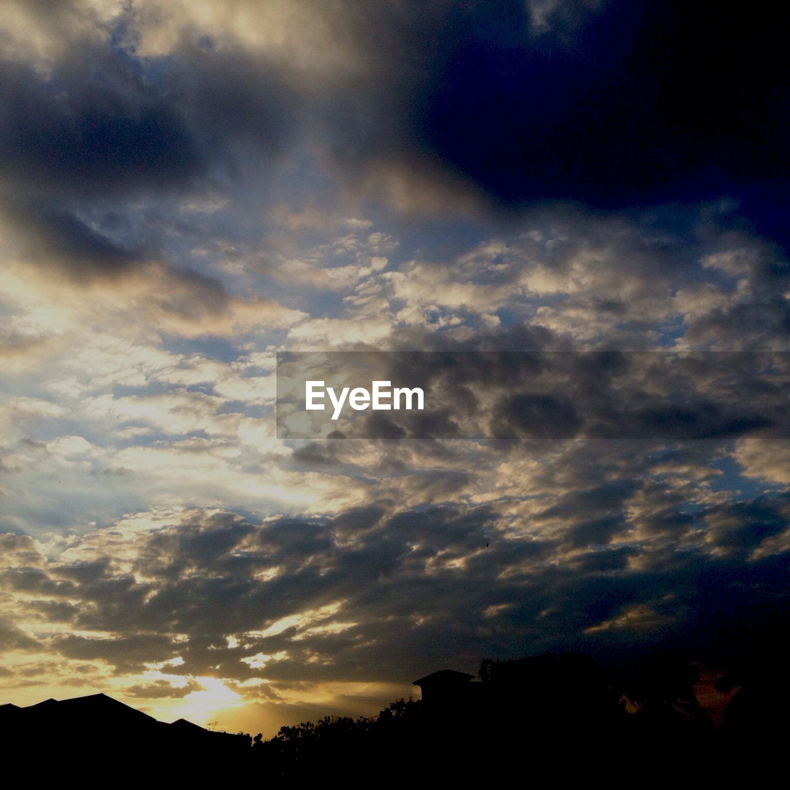 silhouette, sky, sunset, cloud - sky, beauty in nature, scenics, cloudy, building exterior, tranquil scene, cloud, built structure, dramatic sky, tranquility, nature, low angle view, architecture, weather, idyllic, overcast, dusk