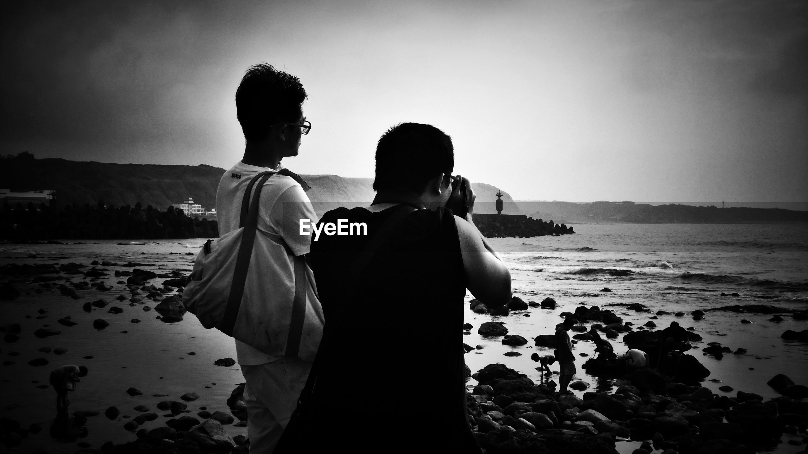water, sea, beach, two people, sky, land, real people, togetherness, women, men, leisure activity, lifestyles, standing, rear view, nature, adult, love, three quarter length, scenics - nature, couple - relationship, positive emotion, outdoors