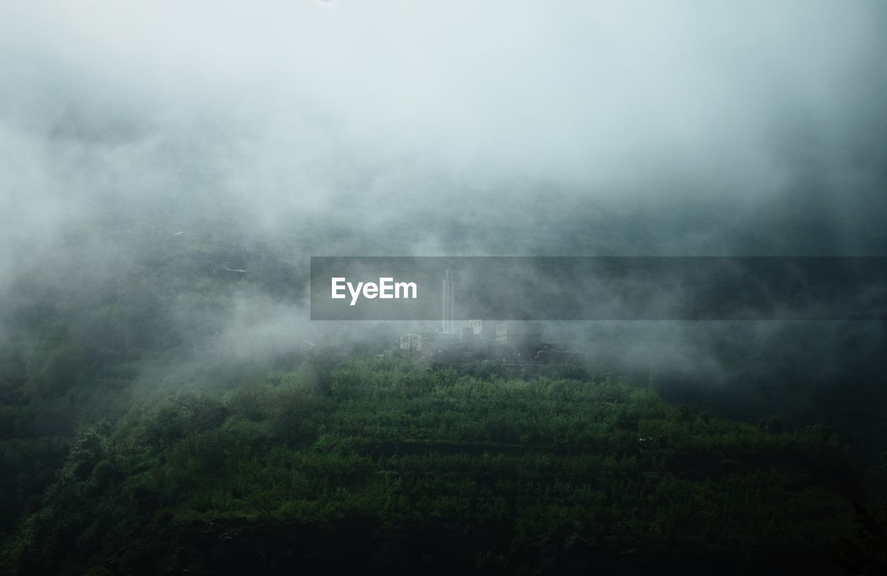 beauty in nature, fog, environment, no people, scenics - nature, cloud - sky, sky, nature, plant, tranquil scene, non-urban scene, landscape, tree, tranquility, green color, outdoors, land, day, mountain, pollution