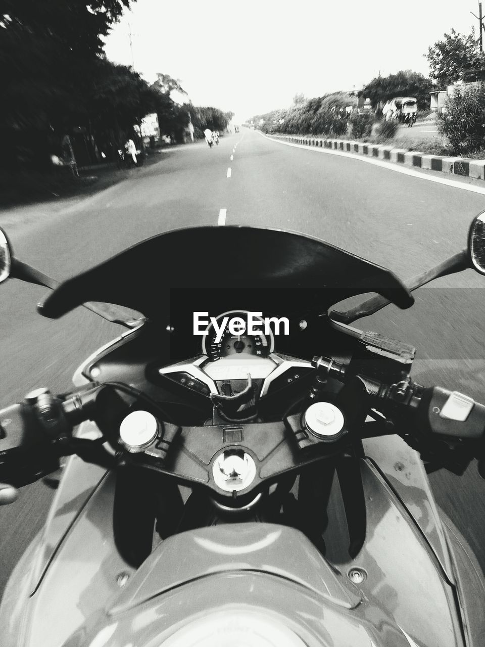 CLOSE-UP OF MAN RIDING MOTORCYCLE ON ROAD