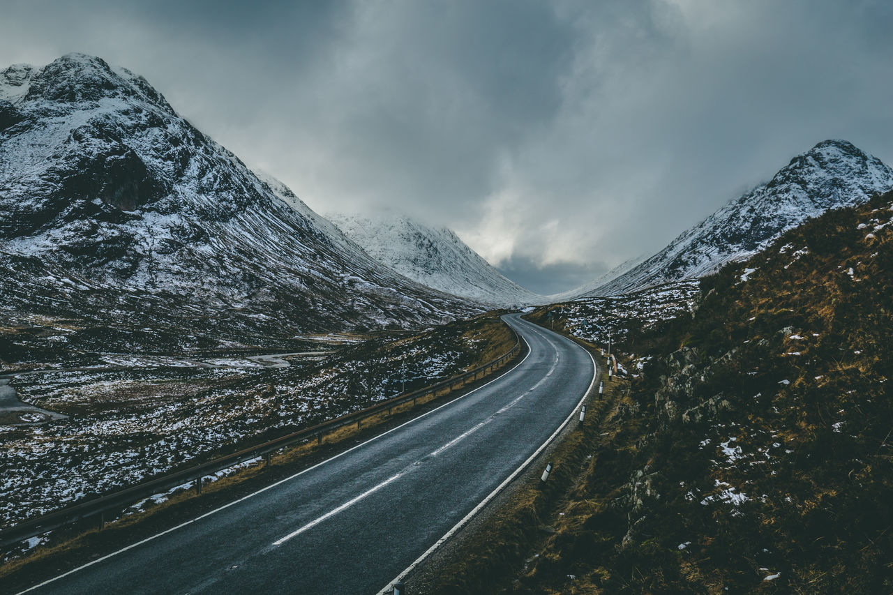 road, cloud - sky, sky, mountain, scenics - nature, transportation, beauty in nature, non-urban scene, no people, direction, the way forward, nature, tranquil scene, tranquility, environment, cold temperature, mountain range, winter, landscape, diminishing perspective, outdoors, snowcapped mountain, dividing line