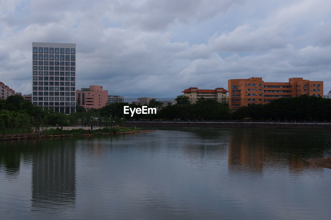 architecture, building exterior, building, built structure, city, sky, reflection, river, urban, water, cloud - sky, no people, outdoors, modern, skyscraper, cityscape, residential, tree, nature, day