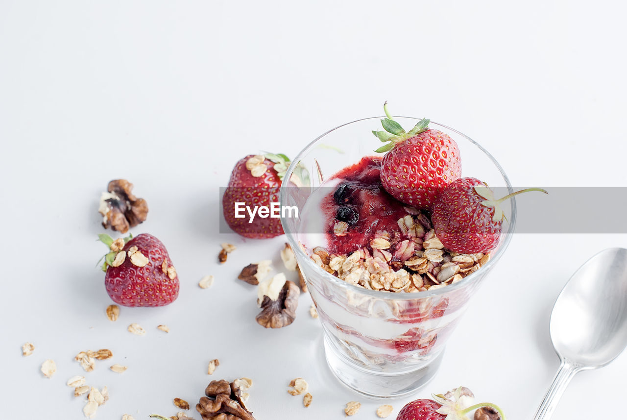 food, food and drink, healthy eating, fruit, freshness, white background, wellbeing, indoors, still life, berry fruit, seed, no people, table, yogurt, close-up, studio shot, dairy product, strawberry, ready-to-eat, sweet food, breakfast, temptation, oats - food, glass