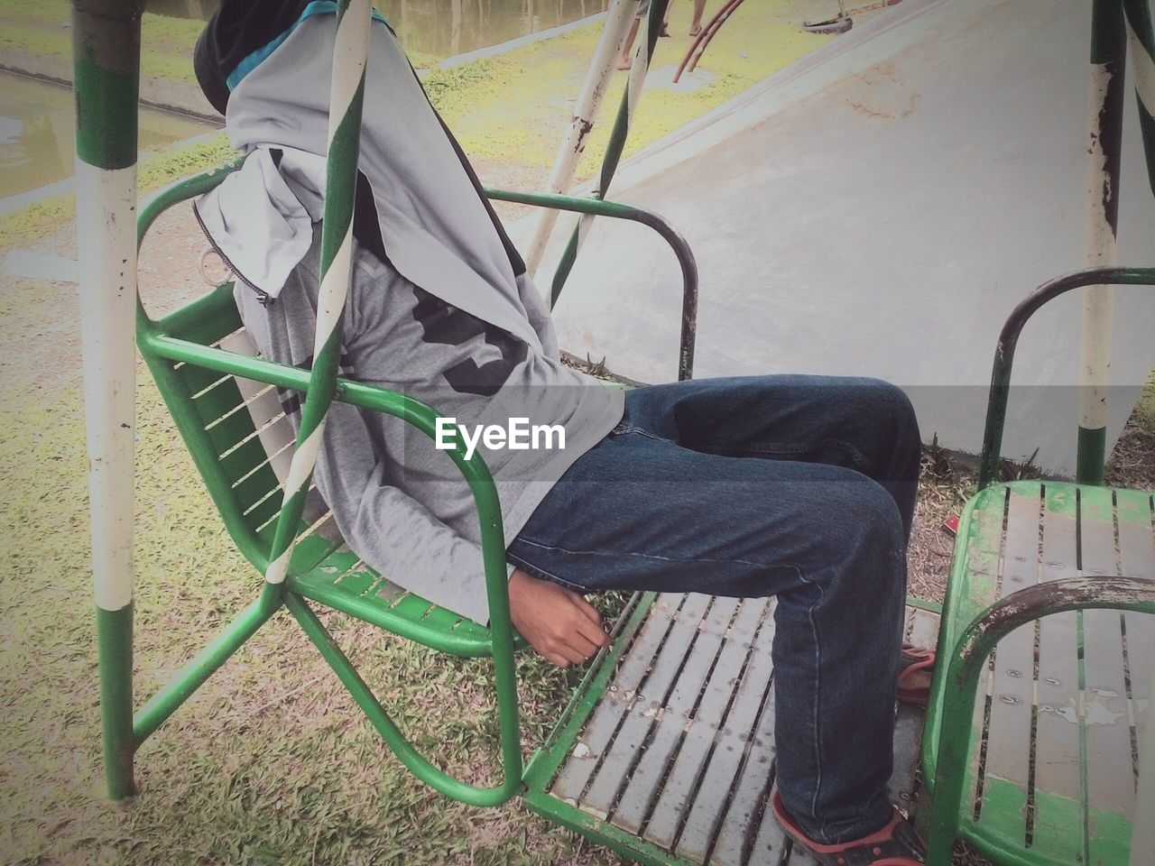 low section, one person, real people, casual clothing, human leg, leisure activity, lifestyles, high angle view, chair, sitting, men, day, outdoors, relaxation, standing, technology, adult, people