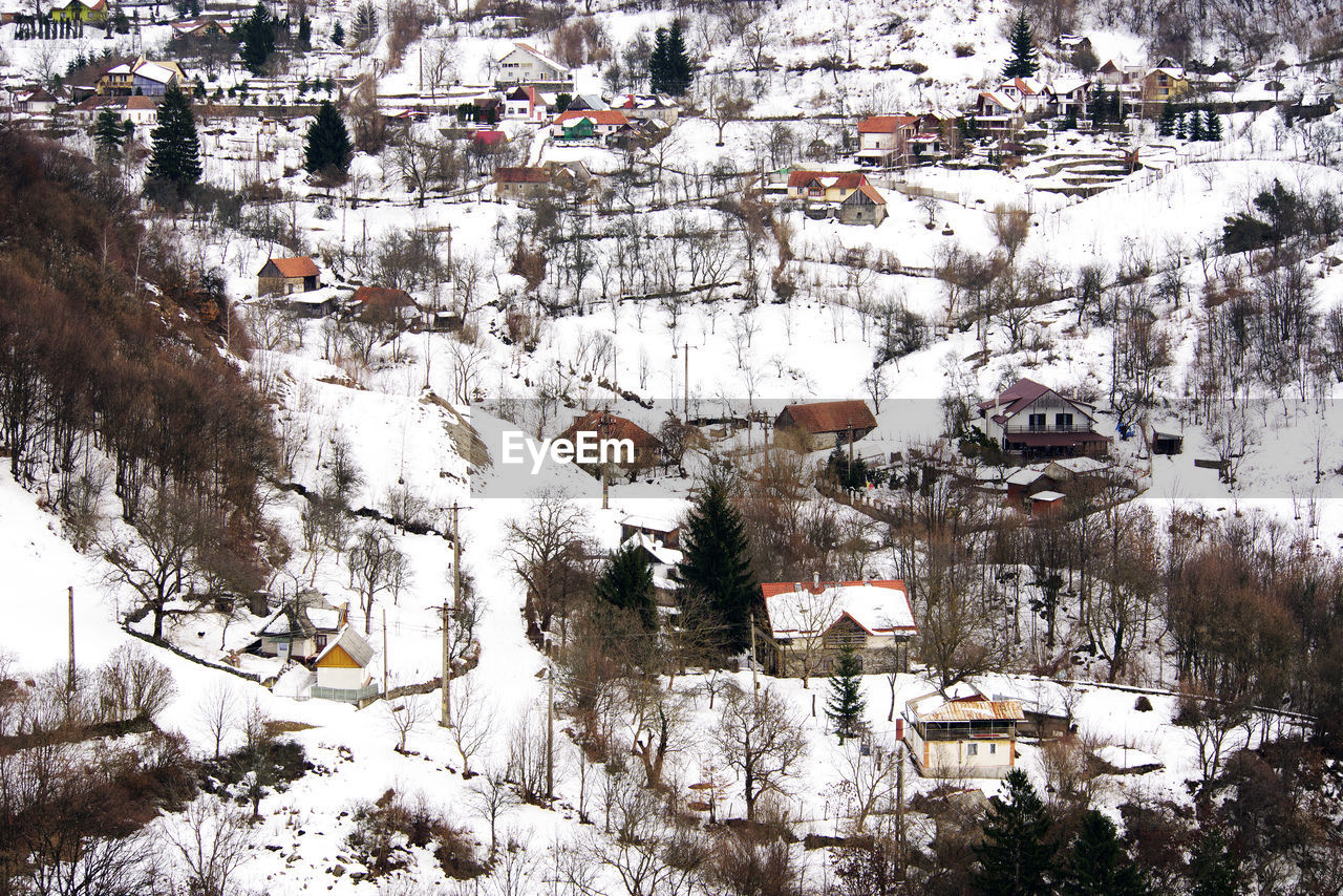 cold temperature, architecture, winter, snow, building exterior, city, building, built structure, environment, no people, town, house, nature, high angle view, landscape, residential district, outdoors, journey, day, place, location, range