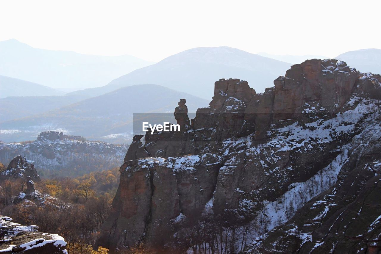 mountain, mountain range, nature, beauty in nature, rock - object, rock formation, tranquil scene, scenics, physical geography, tranquility, day, outdoors, landscape, no people, cold temperature, sky, cliff, snow, peak