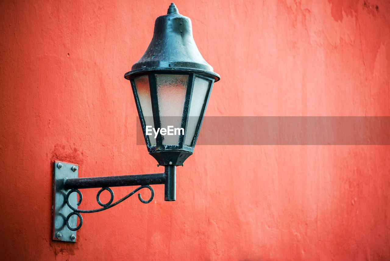 Lamp Mounted Red Wall