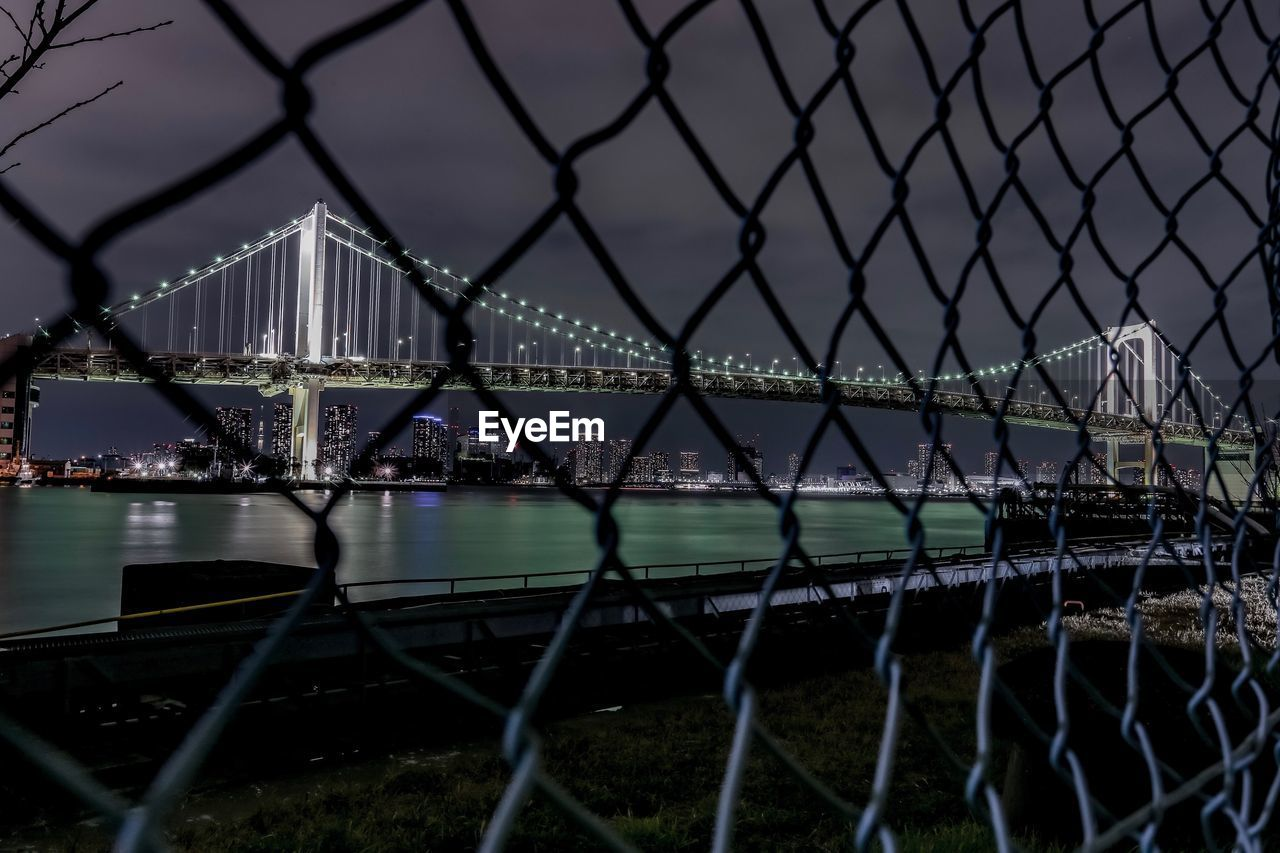 water, fence, built structure, no people, chainlink fence, barrier, metal, nature, connection, safety, architecture, boundary, protection, river, sky, security, outdoors, transportation, bridge - man made structure