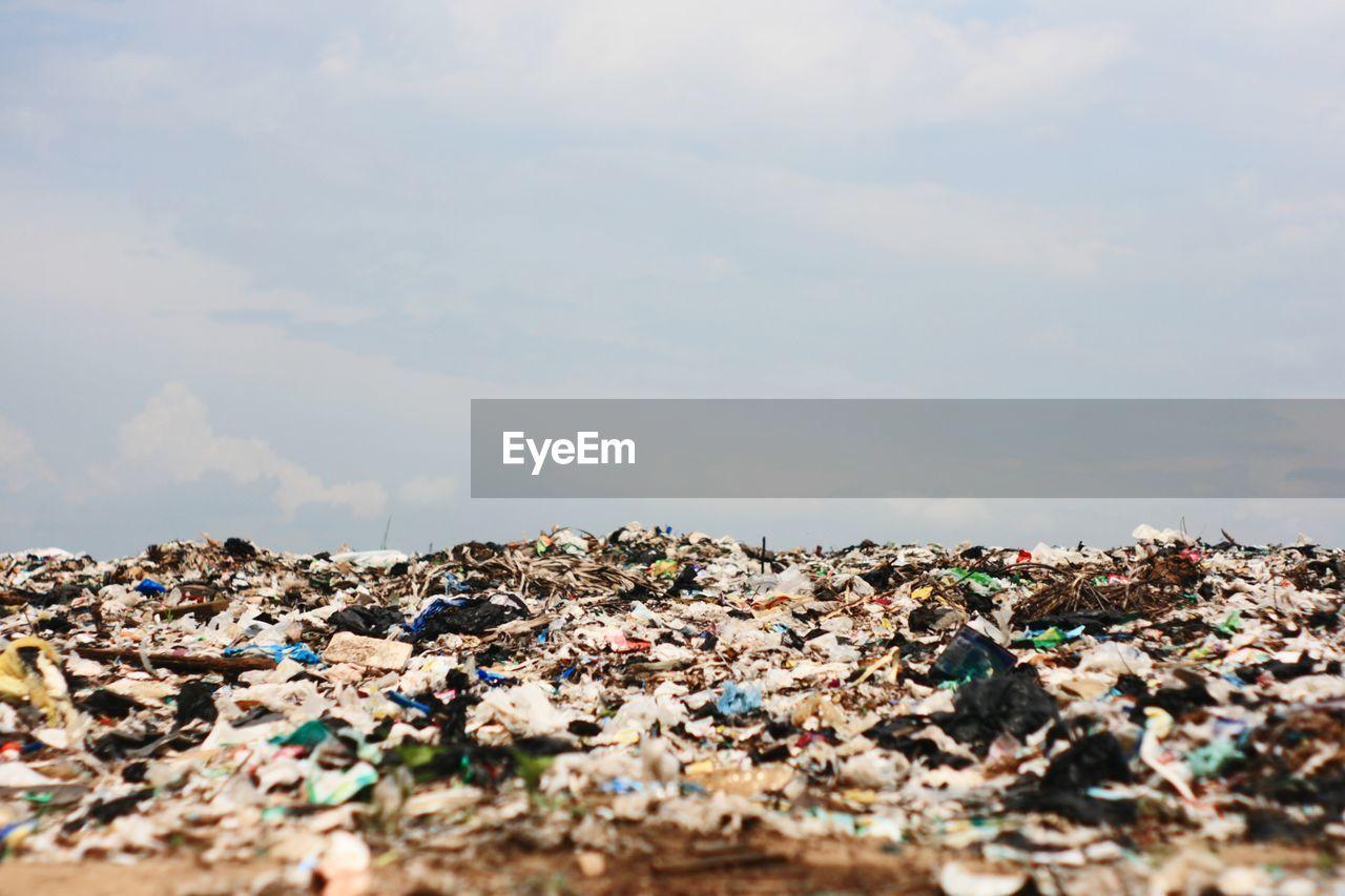 Garbage on field against sky
