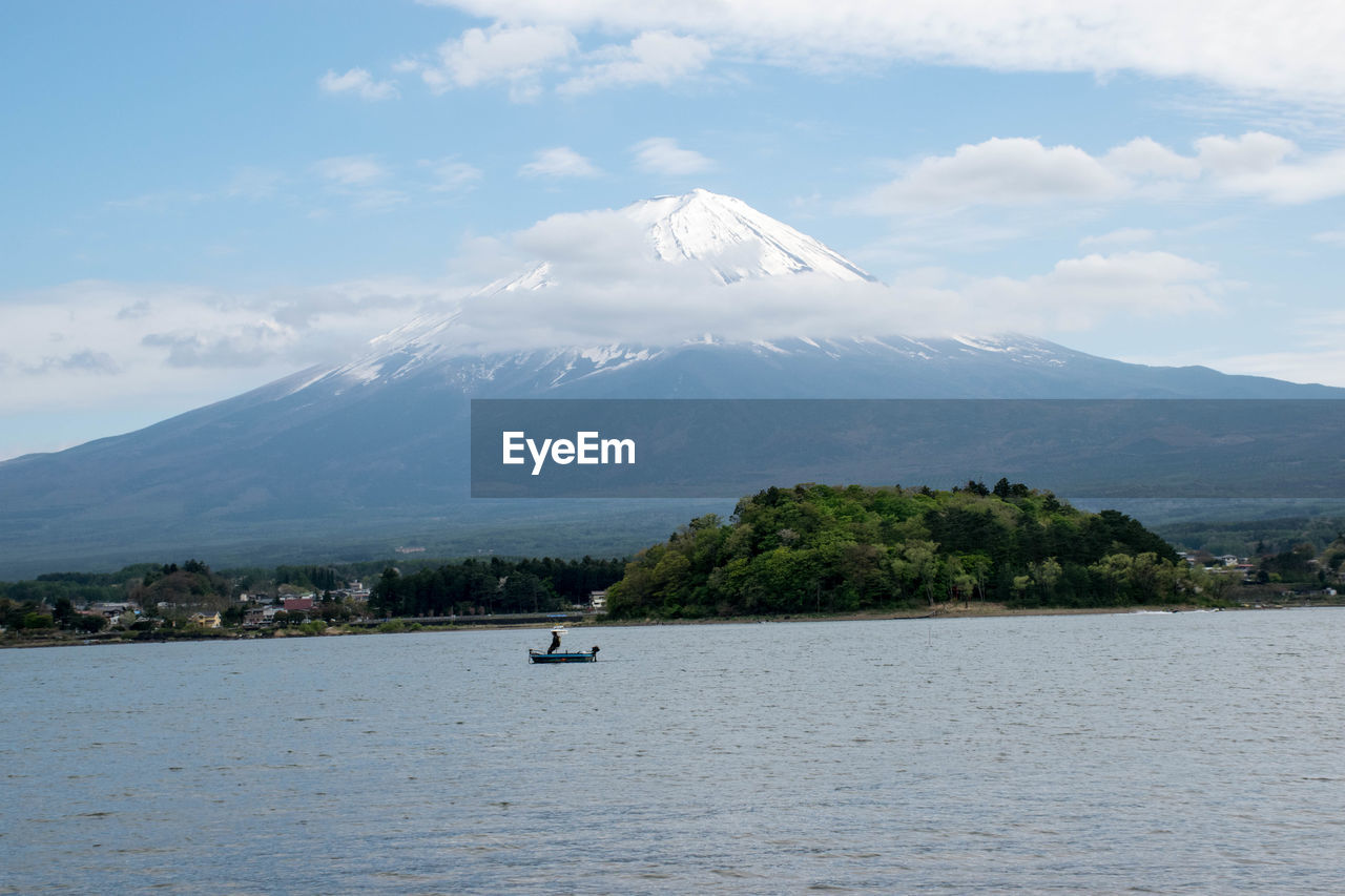 mountain, nature, sky, beauty in nature, scenics, water, day, waterfront, tree, outdoors, lake, peak, no people, scenery
