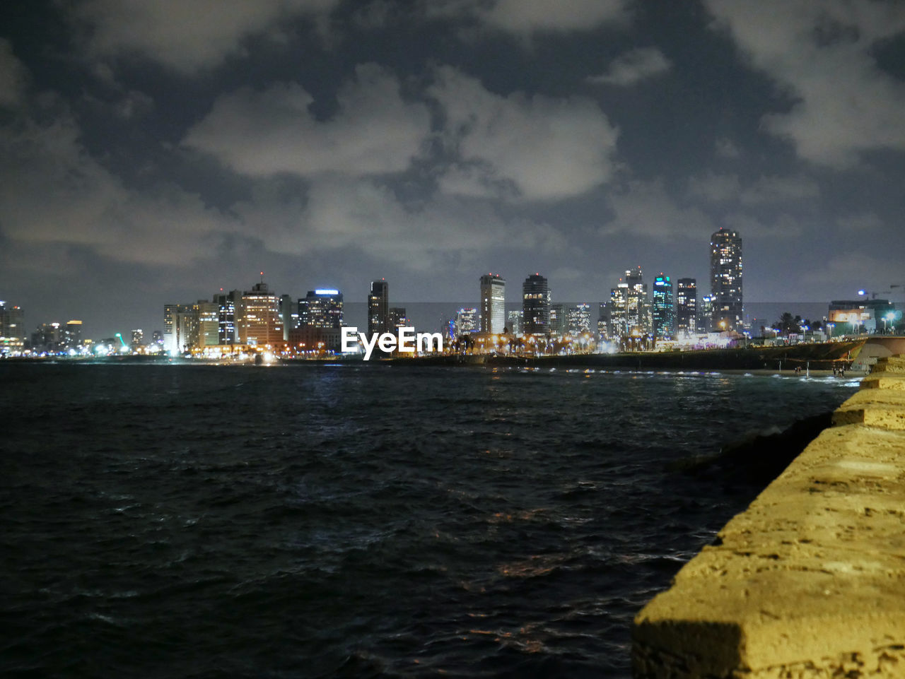 architecture, built structure, building exterior, sky, city, water, building, cityscape, cloud - sky, sea, urban skyline, nature, illuminated, office building exterior, night, waterfront, no people, skyscraper, landscape, outdoors, financial district