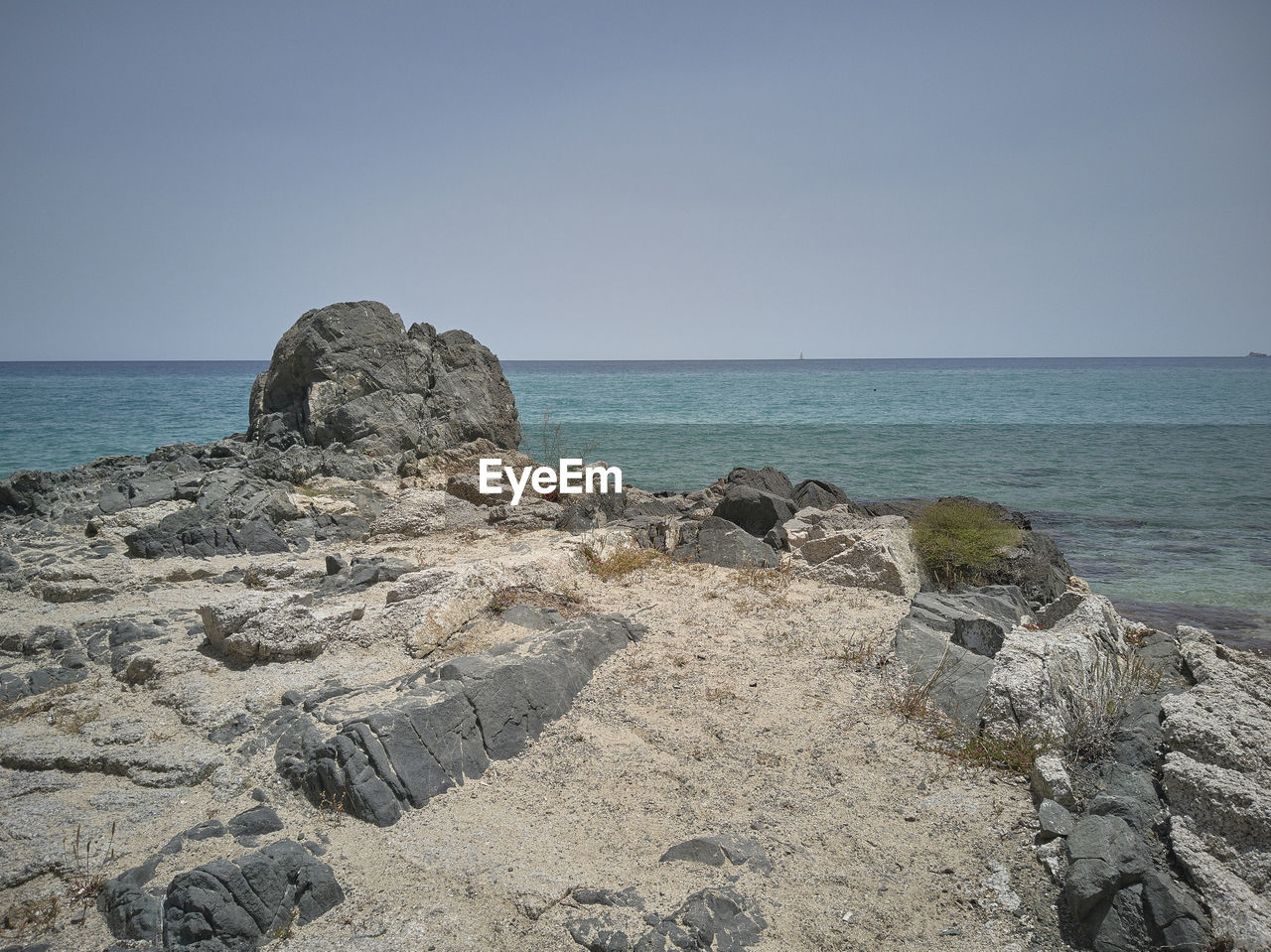 sea, sky, rock, water, horizon over water, horizon, rock - object, solid, beach, clear sky, beauty in nature, scenics - nature, land, nature, tranquil scene, tranquility, no people, rock formation, copy space