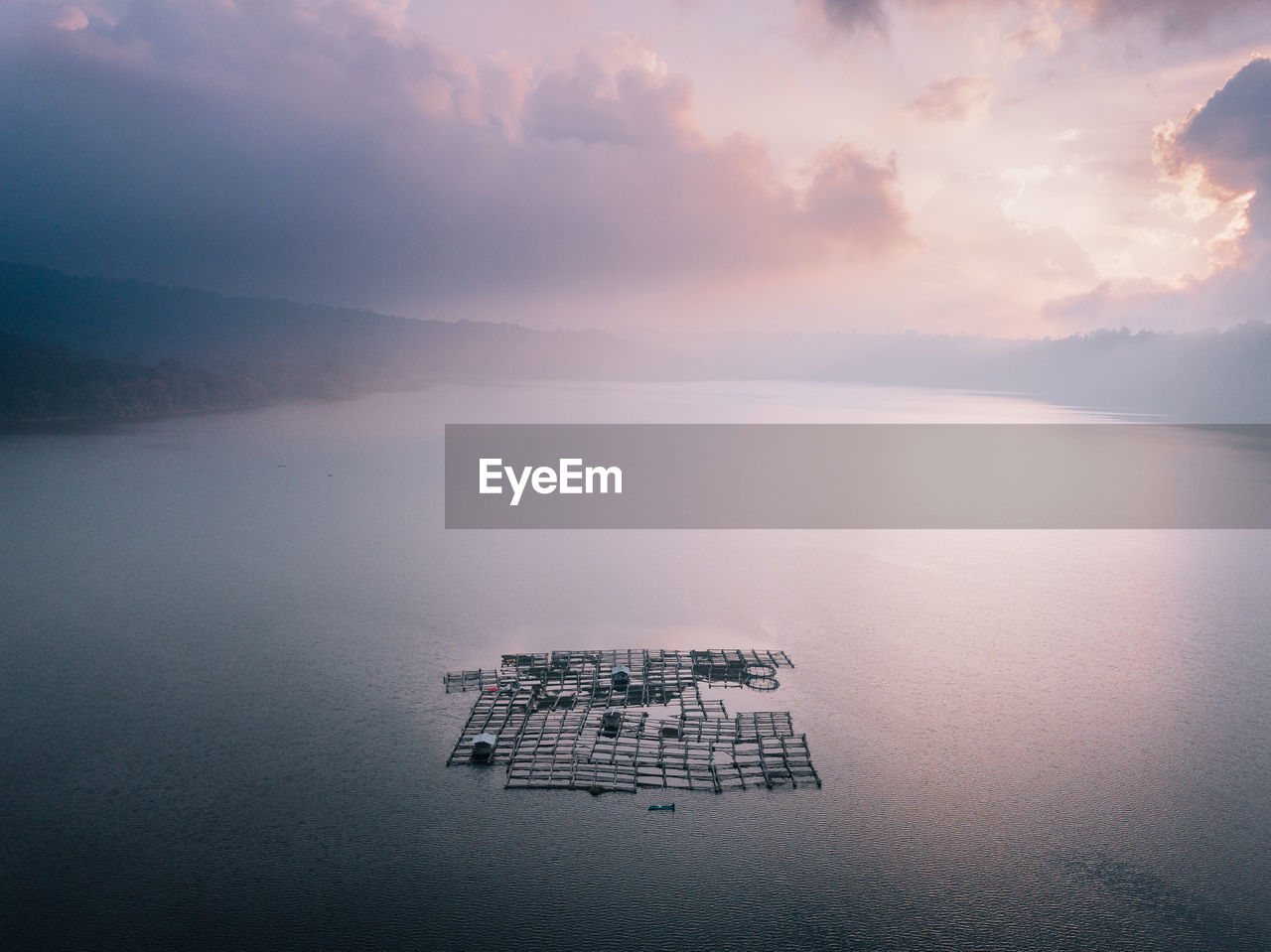 water, sky, scenics - nature, cloud - sky, beauty in nature, tranquil scene, tranquility, nature, waterfront, no people, idyllic, sea, non-urban scene, reflection, fog, day, remote, high angle view, outdoors, floating on water