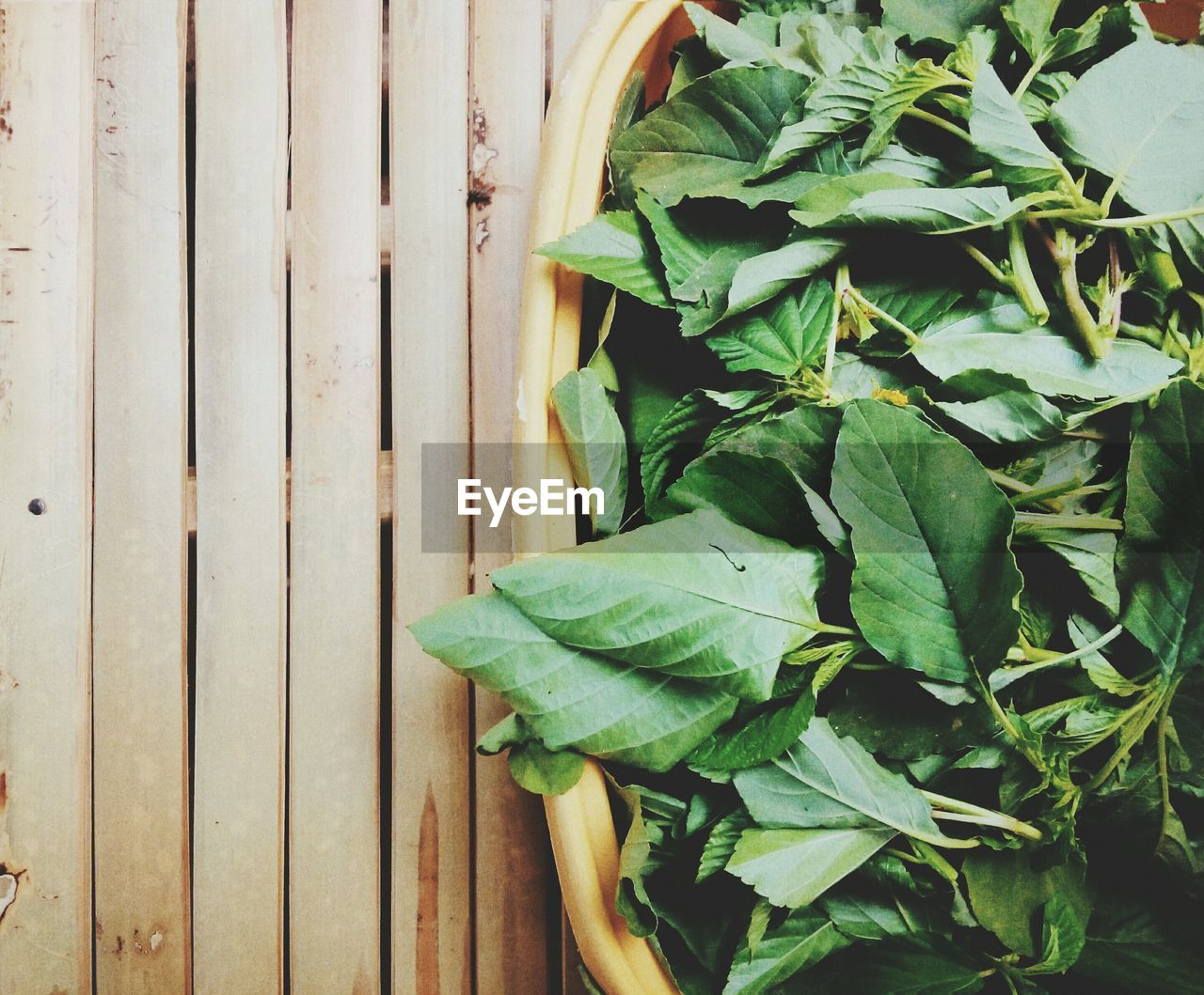 Close-Up Of Leaf Vegetables In Container On Table