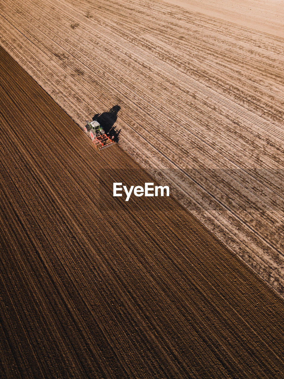 high angle view, land, working, occupation, agriculture, farm, harvesting, landscape, agricultural machinery, one person, rural scene, nature, field, day, environment, agricultural equipment, growth, aerial view, tractor, farmer