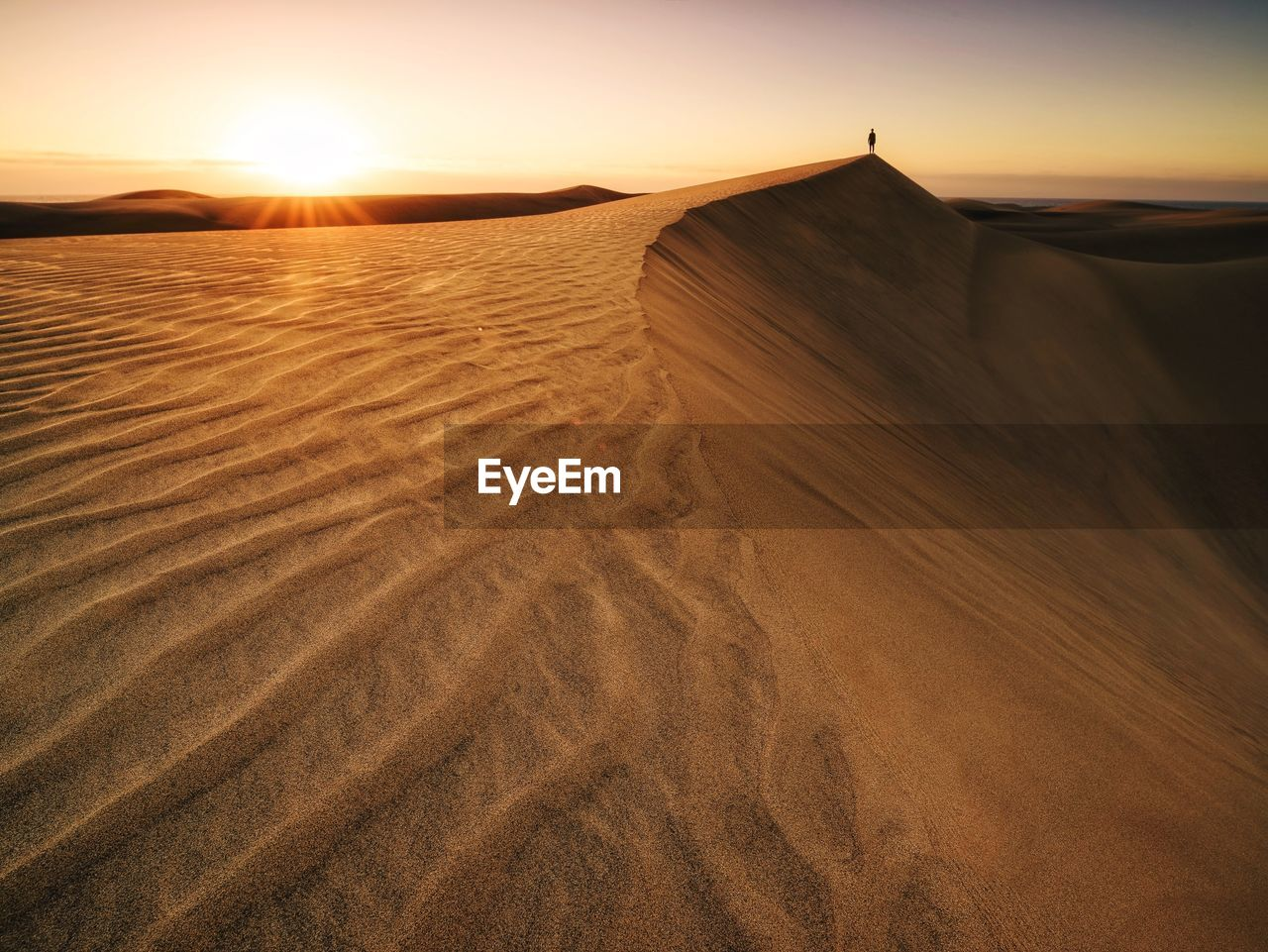 scenics - nature, sand, land, landscape, desert, sand dune, environment, beauty in nature, sky, tranquil scene, tranquility, sunset, arid climate, nature, climate, sunlight, non-urban scene, no people, remote, outdoors, atmospheric