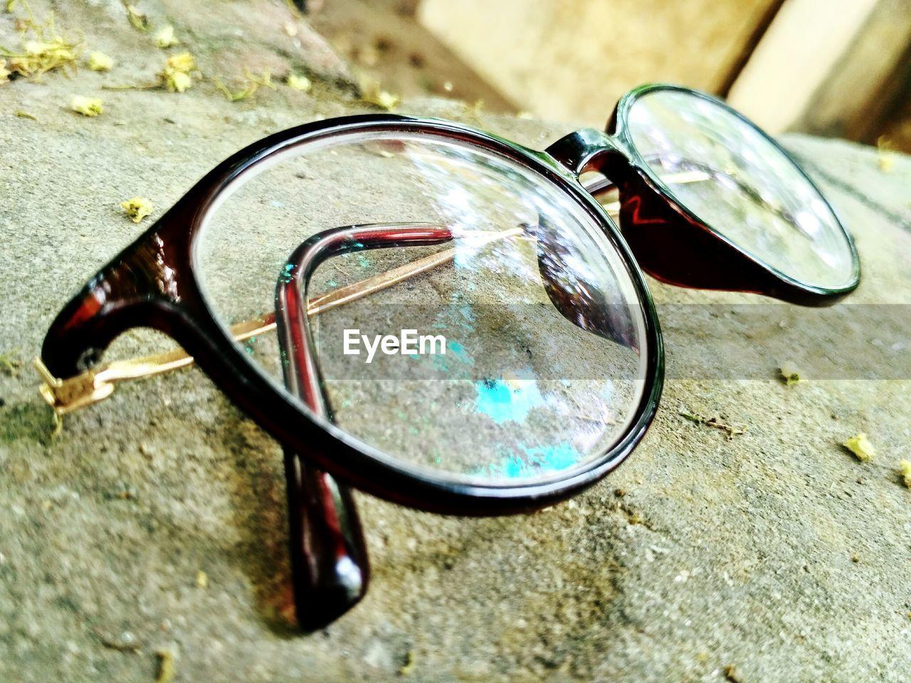 sunglasses, eyeglasses, no people, close-up, reflection, table, glasses, day, eyesight, outdoors