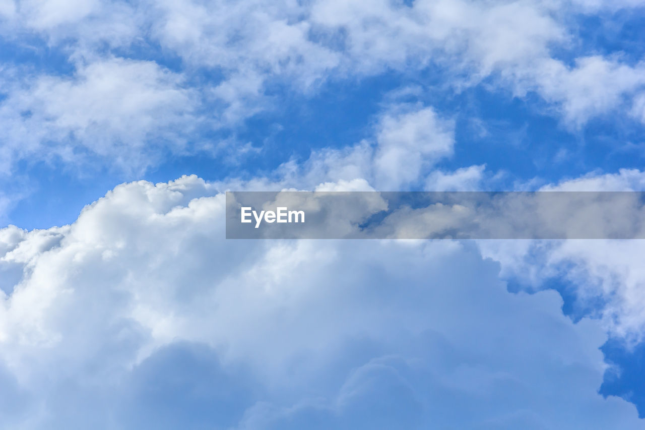 cloud - sky, sky, nature, blue, low angle view, beauty in nature, white color, outdoors, tranquility, day, backgrounds, no people, full frame, scenics, sky only
