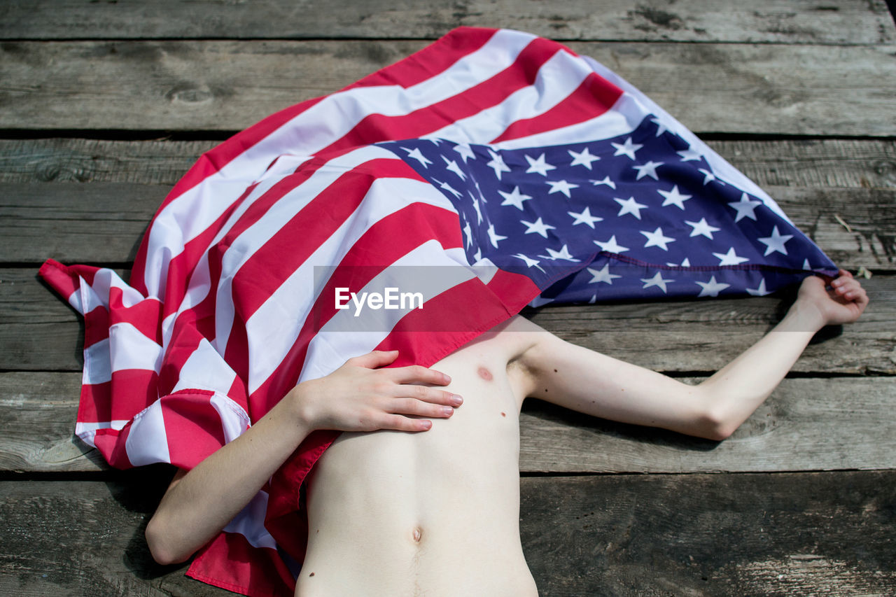 Close-Up Of Boy With American Flag