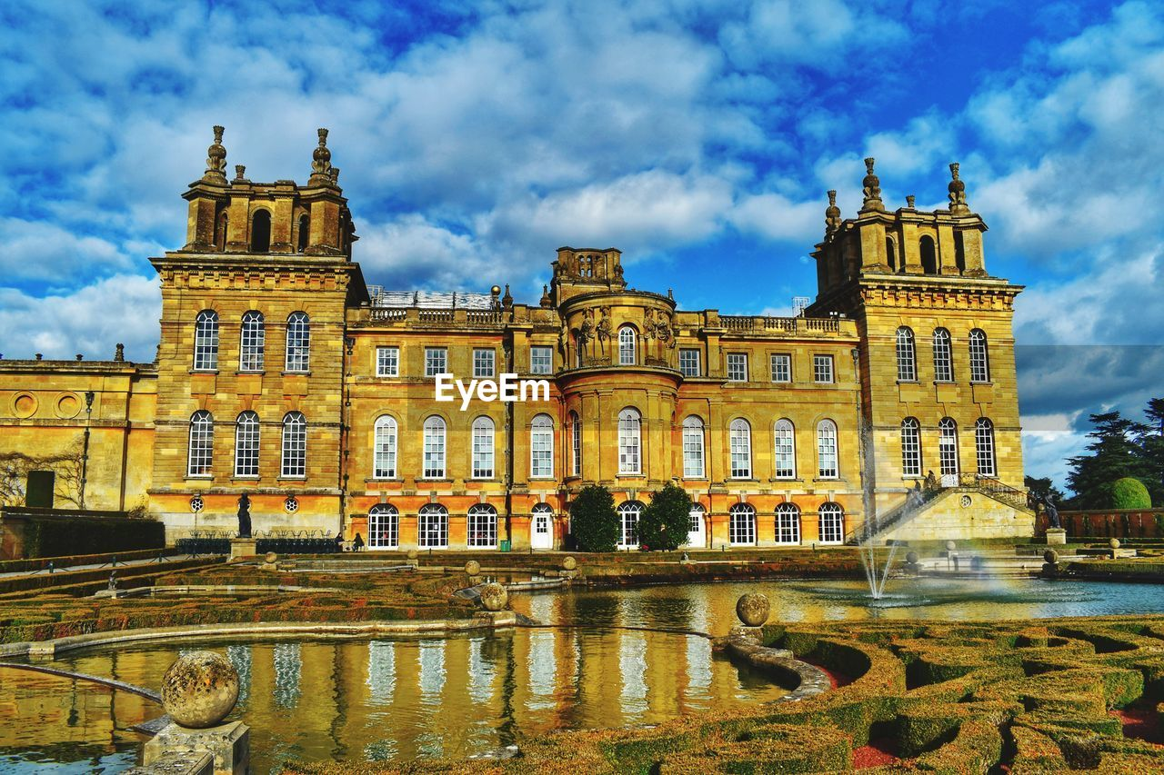 building exterior, built structure, architecture, sky, cloud - sky, water, nature, travel destinations, reflection, incidental people, the past, city, travel, tourism, history, building, outdoors, facade, day
