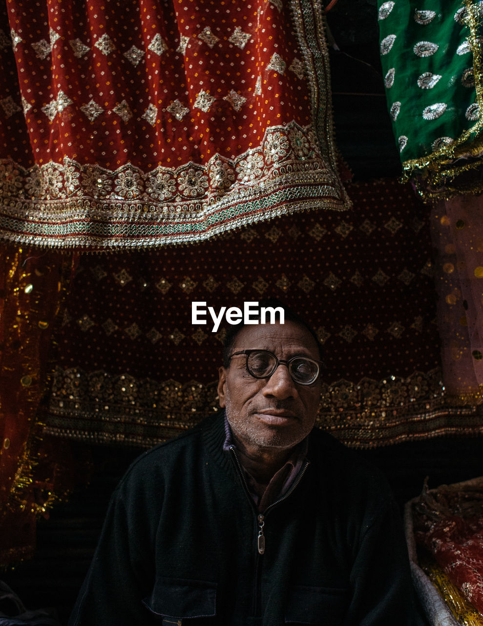one person, eyeglasses, real people, looking at camera, lifestyles, portrait, indoors, night, architecture, people